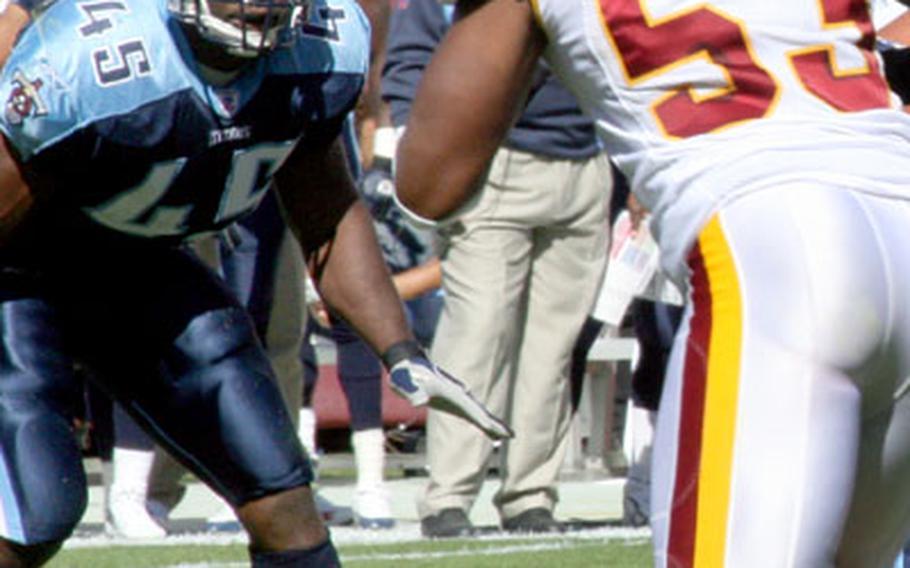 Ahmard Hall keeps an eye on Redskins linebacker Marcus Washington.