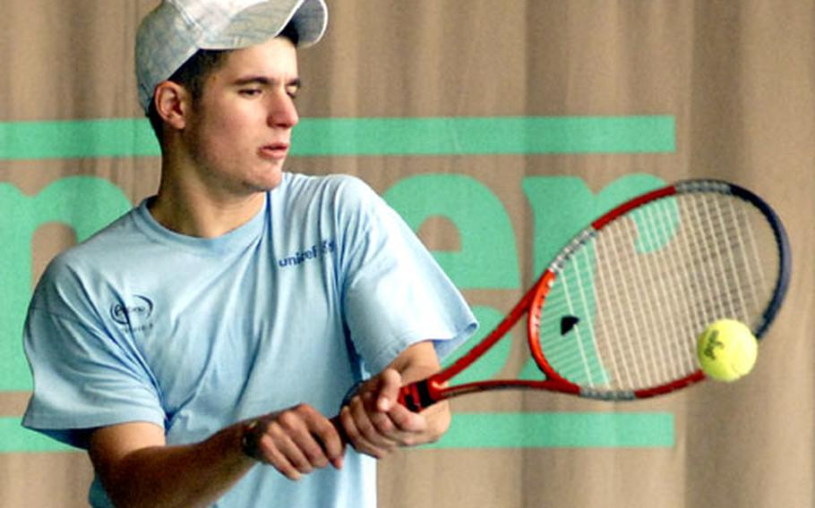 Europe boys defending champ and No, 2 seed Claudio Giraldi of SHAPE returns a shot from sixth-seeded Ryan Umstaedter, in their semifinal match on Friday. Giraldi will face top seed Nick Garcia of Heidelberg in the championship match on Saturday.