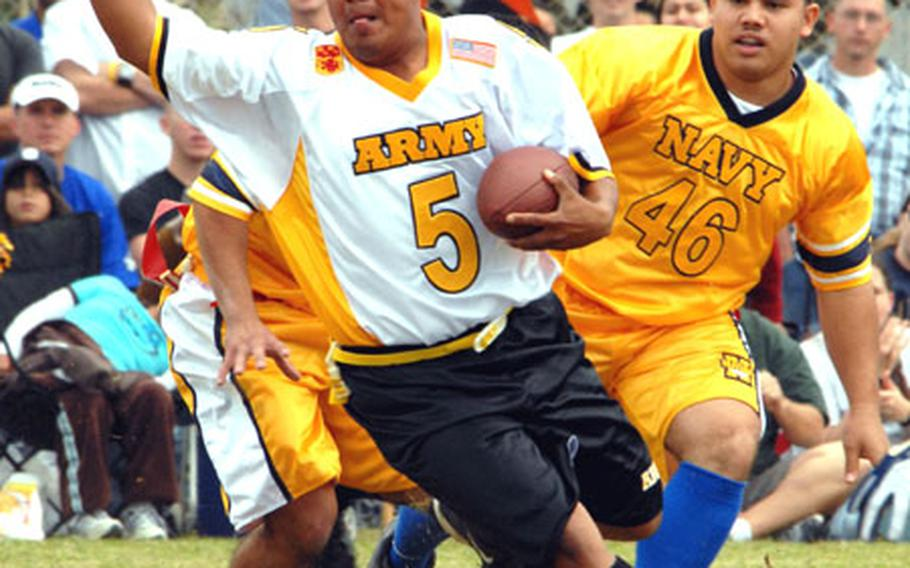 Army running back Brandon Thorne (5) tries to evade Navy defender Rodrigo Carino (46) during Saturday's Army-Navy flag football game at Torii Station, Okinawa. Army won the second-highest scoring game in the 17 years of the rivalry, 49-28.