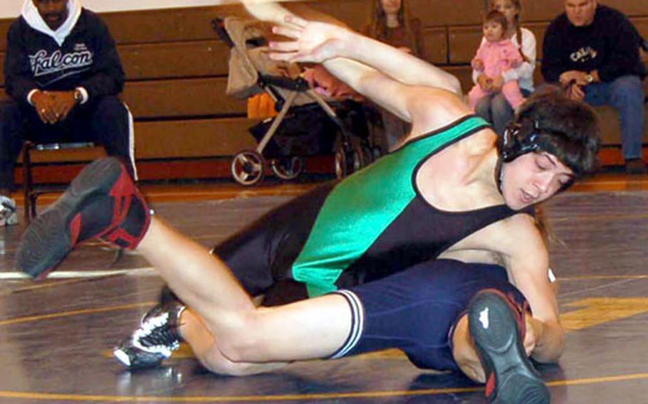 Torian Whetstone of Taegu American pins Ryan Bailey of E.J. King during Saturday's quadrangular wrestling meet at Taegu American School.