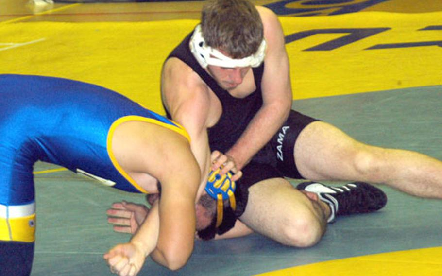 Yokota's Kyle Shimabukuro, left, tangles with Tim Campbell of Zama in the semifinals of the 180-pound division during Saturday's Kanto Plain Invitational. Shimabukuro emerged with the win on points.