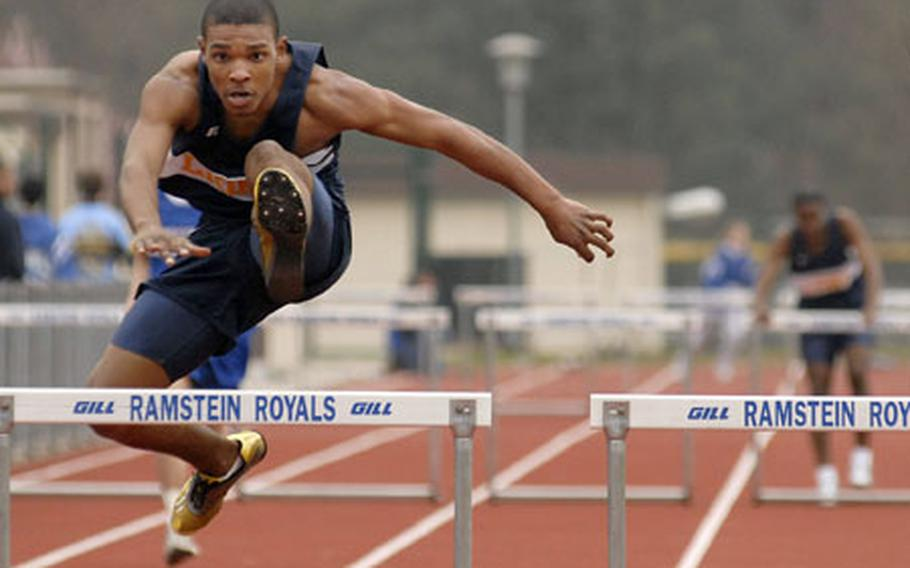 Romonno Washington, an junior from Heidelberg High School, clears the final hurdle on his way to winning the 300- meter low hurdles with a time of 45.94 seconds at a track meet at Ramstein High School on Saturday.