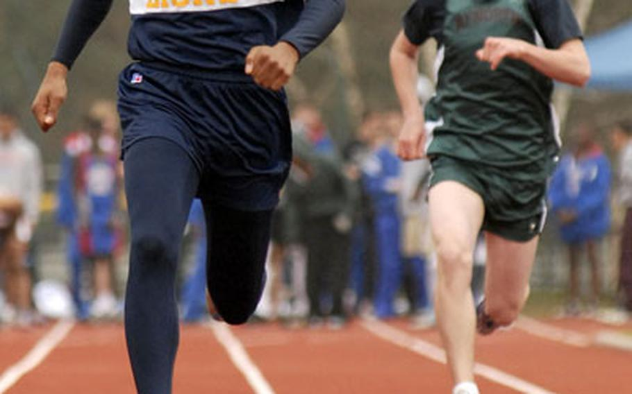 Chris Frazier, a sophomore from Heidelberg High School, sprints to the finish line to win the 100-meter dash in 11.28 seconds during a track meet at Ramstein on Saturday.