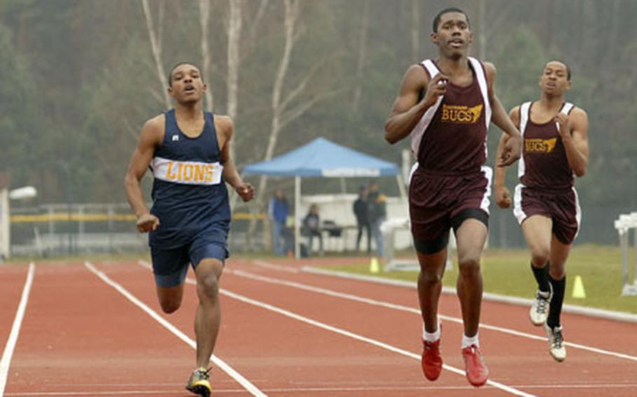 True Davis, center, a senior from Baumholder High School, sprints to victory in the 400-meter dash Saturday at Ramstein. He finished in 54.16 seconds.