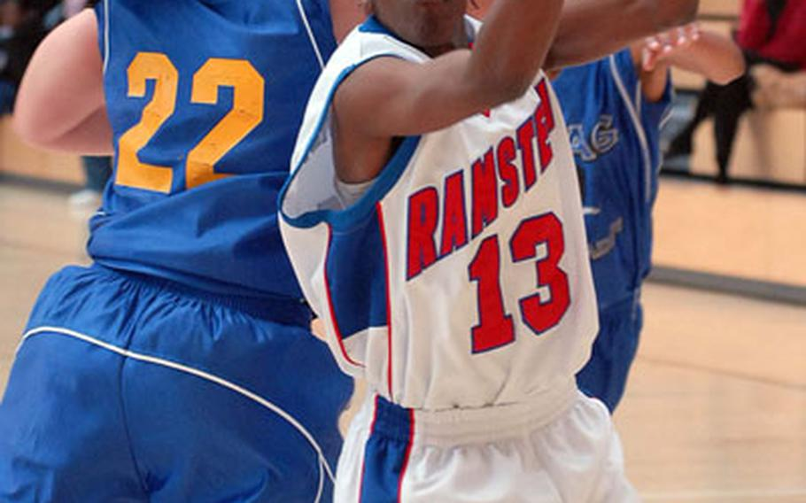 Ramstein's Cheryl Burney, right, pulls down a rebound in front of Wiesbaden's Atesha Potter in the women's final of the Army-Air Force Final Four in Wiesbaden, Germany, on Sunday.