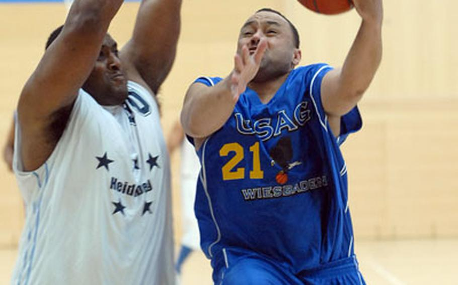 Wiesbaden's Donald Craig, right, goes to the basket against Heidelberg's Harry Davis at the 2007 Army-Air Force Final Four in Wiesbaden, Germany, on Sunday night. Wiesbaden needed an if-necessary game to take the title in an all-Army final, defeating Heidelberg 69-56.