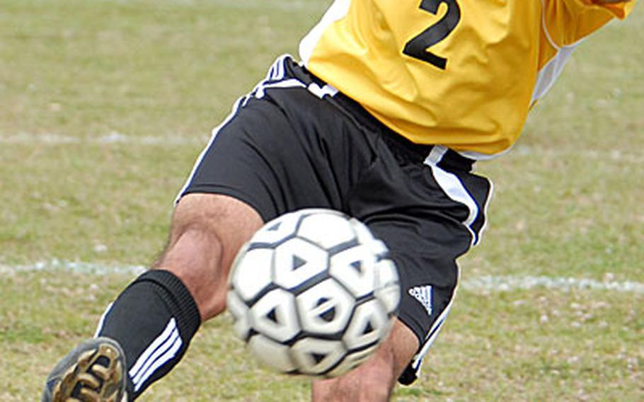 Jacob Bloom (2) of the Kadena Panthers boots the ball toward the Okinawa Christian International Crusaders' goal.