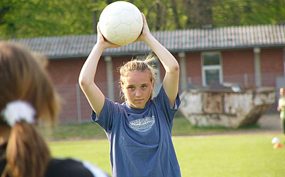 Fallon Puppolo, an All-Europe defender last season with the Heidelberg Lady Lions, practices her throw-in style Monday during a practice with her German team, VfB St. Leon Rot.