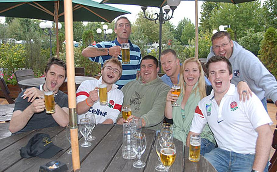 From left: Rugby fans Chris Williams and William Hollins-Gibson of England; Willie Power of Ireland (standing); Americans David Delozier and Rick Cook; Louise Farrell and Tom Deacon of England; and American Joe Schwab (standing) share a few beers at a Paris campground before setting off to watch Saturday's U.S.-England Rugby World Cup match.