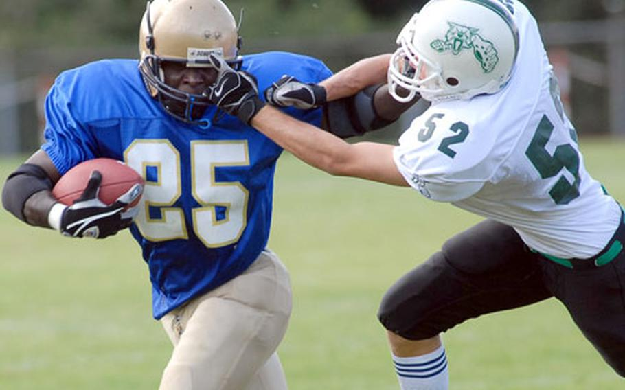 Wiesbaden's Ron Peebles, left, tries to keep Naples Wildcat Peter Lawton at arms length as he picks up yardage in an opening day game of the 2007 DODDS-Europe football season. Naples beat Wiesbaden, 31-29, in an exciting, non-conference Division II matchup.