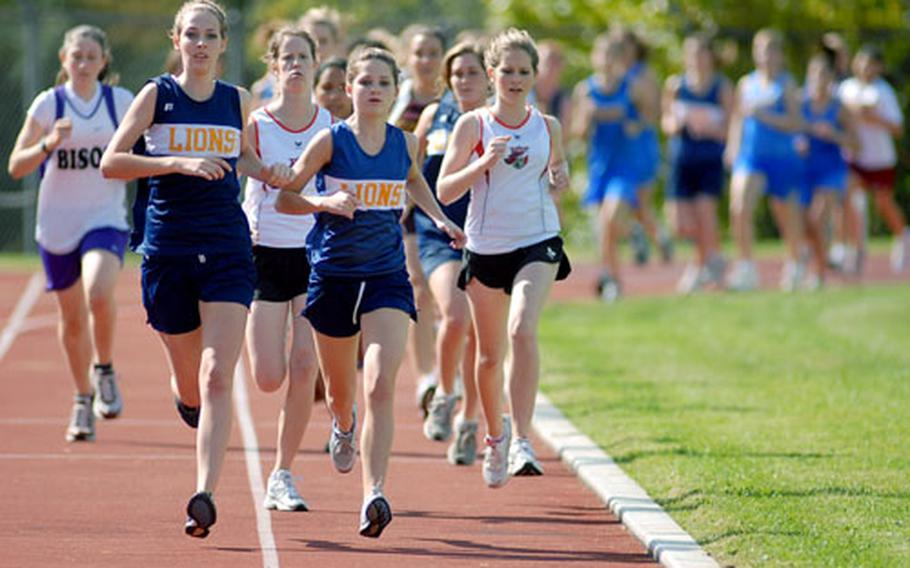 Heidelberg's Julie Caldwell, second from left, leads the runners off into a new cross country season in Wiesbaden on Saturday. Caldwell won the race in 22 minutes, 40 seconds ahead of teammate Lauren Brousseau and Alison Ochoa of Wiesbaden. Heidelberg won the girls team comeptition, with Wiesbaden second and Baumholder third.