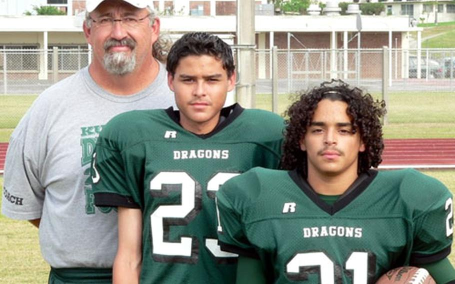 """Kubasaki Dragons coach Fred Bales and sons Caleb, middle, and Josh as Dragons players in 2006, when Caleb was a senior and Josh a freshman. Josh is in line to be one of a """"running back by committee"""" for the Dragons."""