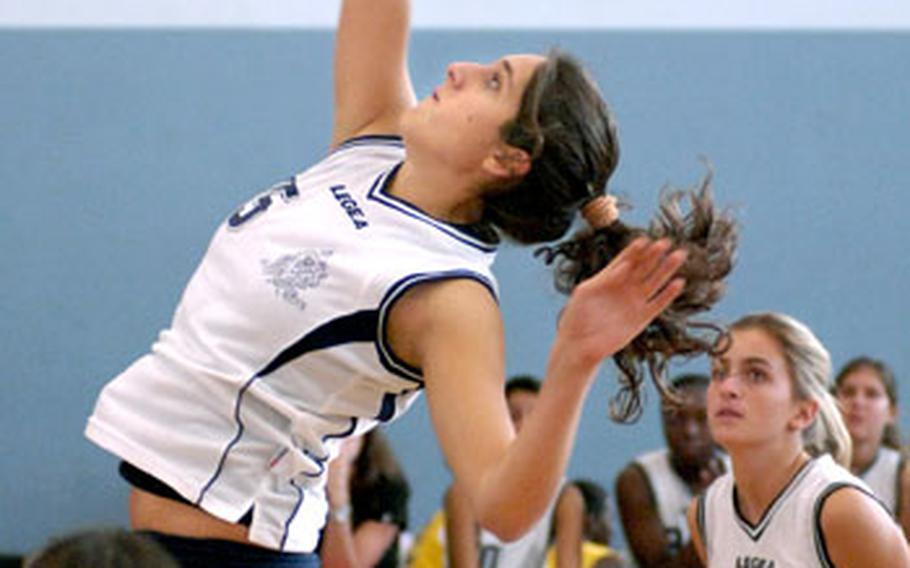 Ilaria Montanari, a sophomore from Marymount International School in Italy, spikes Thursday during the opening day of Championship play in Vogelweh. Div. III Marymount defeated American Overseas School of Rome 25-19, 26-24 in a Division III contest.