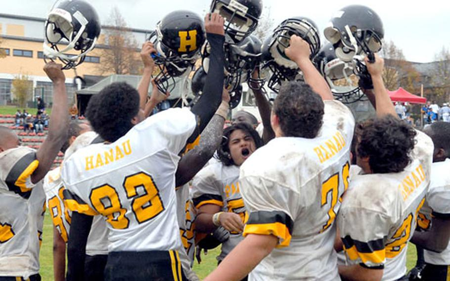 The Hanau Panthers celebrate their Division IV title in the school's final game after beating Menwith Hill 58-20.