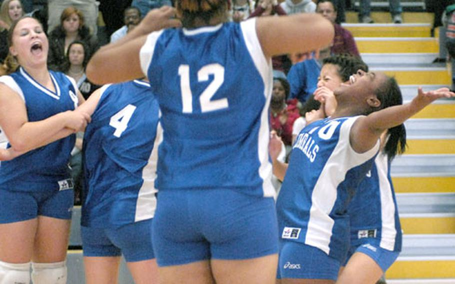 Gregoria Johnson, right, and Kayleigh Cradeur, left, both seniors from Rota High School, react to their team's victory Saturday at Ramstein. Rota defeated Hanau in the Div. IV championship game 25-19, 25-22, 25-18.