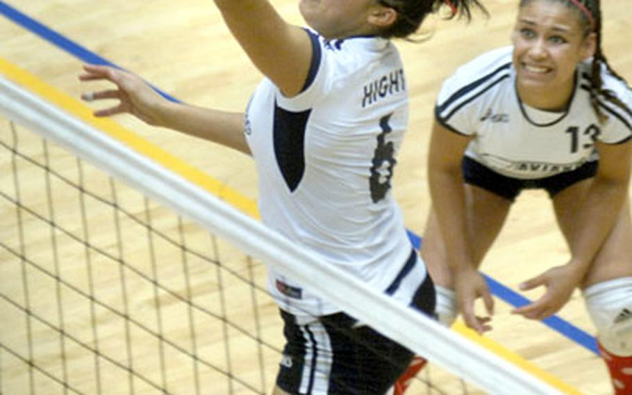 Tiffany Hight of High School leaps for a spike against SHAPE as Danielle Garcia looks on Saturday at Ramstein. Aviano crushed SHAPE in the Div. II championship game 24-13, 25-12, 25-15.