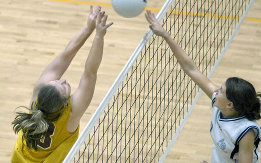 Elena Carrarino of Marymount International School meets Katrina Alsup of Baumholder at the net Saturday at Ramstein. Marymount defeated Baumholder in the Div. III championship game 25-7, 27-29, 25-11, 13-25, 15-4.