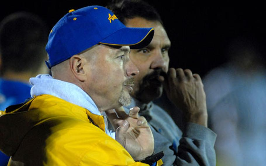 Ansbach head coach Marcus George, left, watches with defensive coordinator Gary Feletar, as the Cougars captured the Division II crown with a 44-8 win over Bitburg on Nov. 3.The European Football Coaches Association voted George the DODDS-Europe coach of the year for the second straight year.
