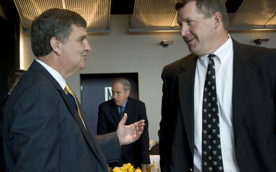 Coaches Paul Johnson of Navy, left, and Stan Brock of Army chat during the recent Army-Navy game media day at Baltimore.