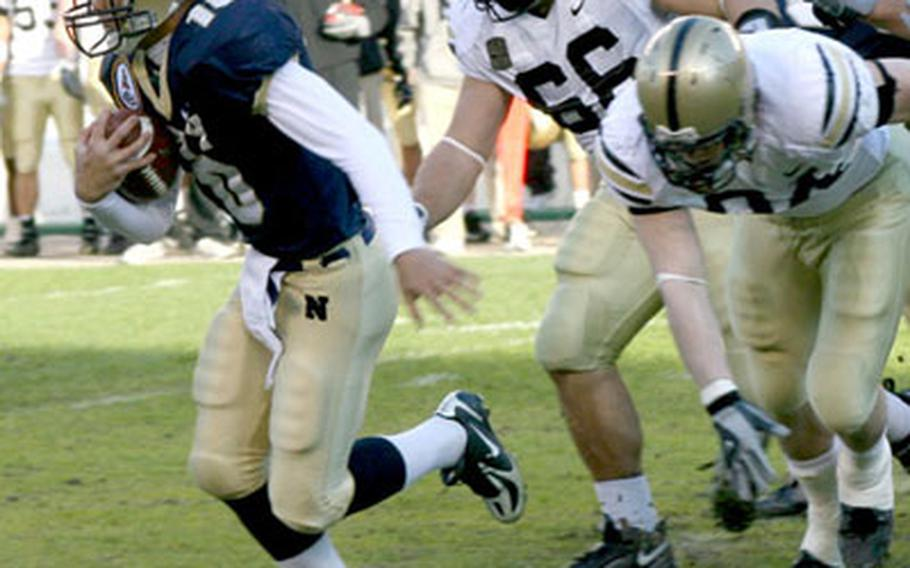 Navy quarterback Kaipo-Noa Kaheaku-Enhada breaks away from Army defenders Tony Fusco (66) and Cameron Craig during the 2006 Army-Navy game. Kaheaku-Enhada has rushed for 755 yards and completed 46 of 79 passes for 823 yards in 2007.