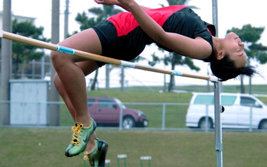 """Sophomore Kristy Taylor of Seoul Track Club clears 4 feet, 10½ inches Friday to capture the girls high-jump portion of the 6th Alva W. """"Mike"""" Petty Memorial Track and Field Meet at Camp Foster, Okinawa."""