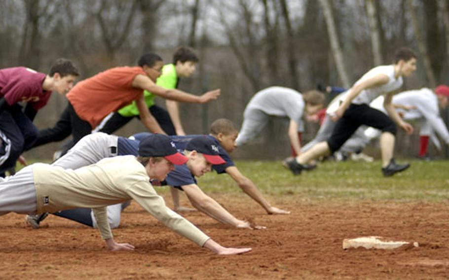 """Shaun Kemp, front, a freshman at Kaiserslautern High School, slides with the rest of his """"Vogelweh 1"""" baseball team during a base-stealing exercise at a practice Wednesday at Ramstein, Germany. Because DODDS doesn't offer baseball as an official sport in Europe, the Morale Welfare and Recreation's Child and Youth Services runs what passes for the high school baseball program."""