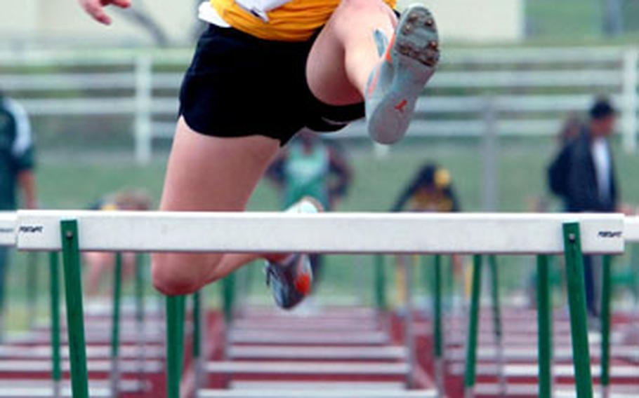 Kadena sophomore hurdler Shannon Steele runs the 100 hurdles. Competing in separate heats, Steele edged teammate Alisha Juko, 18.095-18.100.