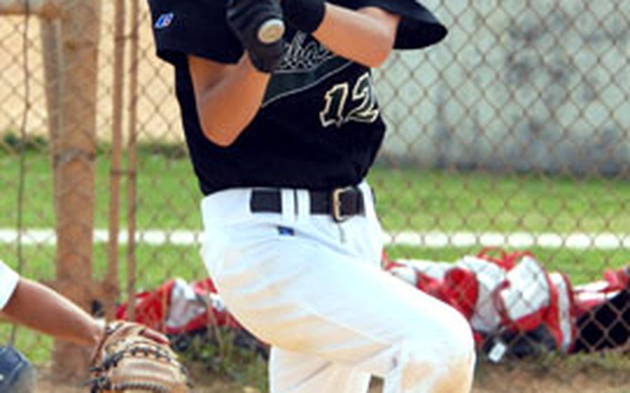 "Patrick ""Duck"" Duffy lines a base hit during Kubasaki's 11-2 victory over Ginowan B on Saturday at Chibana Recreation Area, Okinawa."