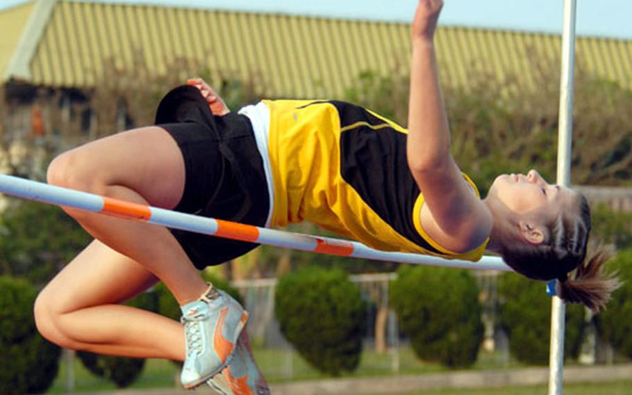 Sophomore Shannon Steele of the Kadena Panthers clears 4 feet, 7¾ inches in the high jump portion of Friday's 2008 Okinawa Activities Council district track and field meet. Steele finished second to Kelly Colbert of Zion Christian Academy, who cleared 4-10½.