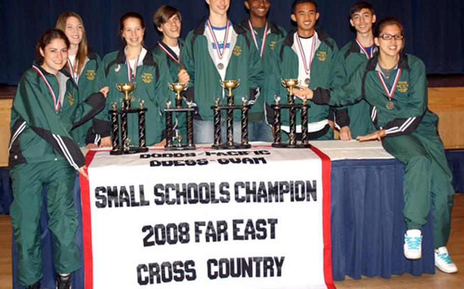 Robert D. Edgren cross-country runners display their title wares Nov. 4 after the 2008 DODDS-Pacific Far East high school cross-country Meet.