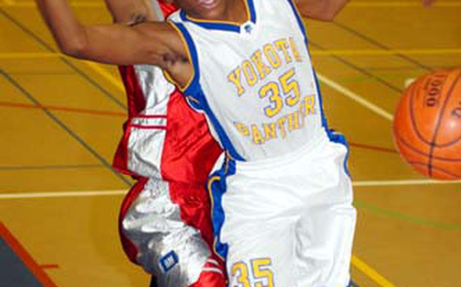 Kenneth Dixon, left, of the E.J. King Cobras and Keron Brown of the Yokota Panthers chase a loose ball during Saturday's DODDS-Japan Basketball League boys high school game at Capps Gym, Yokota High School. The Panthers beat the Cobras 62-30.