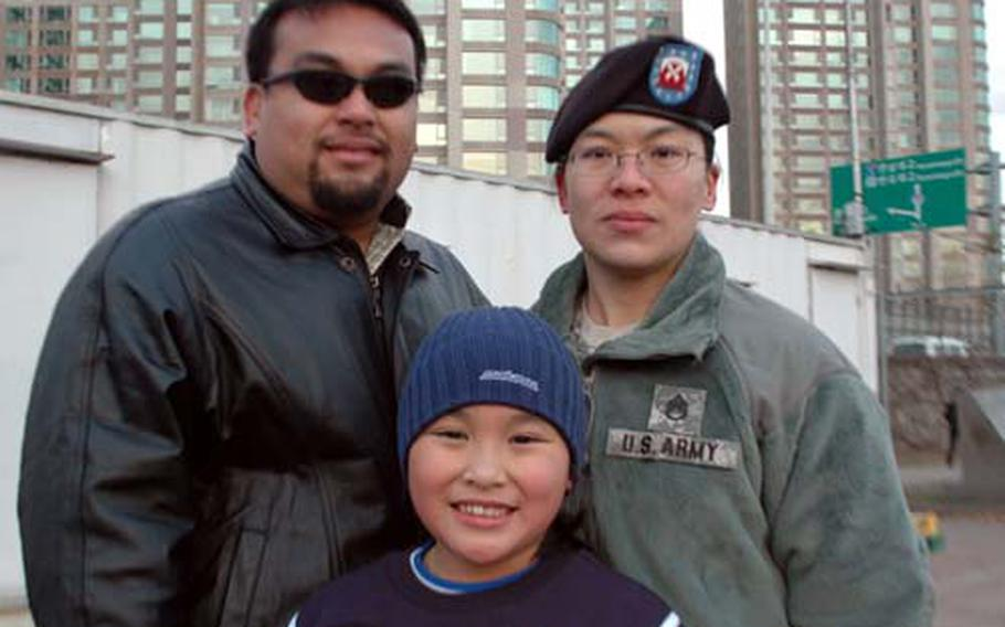 Camille Pereira with her parents, Philip Perez and Staff Sgt. Elizabeth Perez.