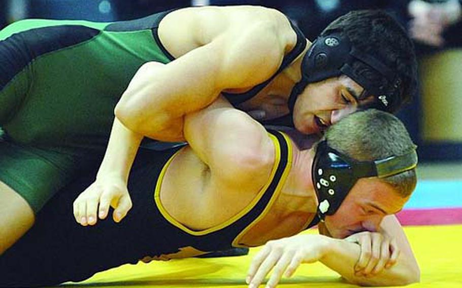 Chris Campos of Naples, top, puts the pressure on Hanau's Aubry Blad in the 119-pound final in the DODDS-Europe wrestling championships in Wiesbaden, Germany, in February. Campos, who won the title, this year is aiming for the 125-pound crown, although last weekend he wrestled at 135 pounds in hopes of finding tougher competition.