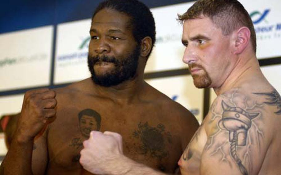 """Riddick """"Big Daddy"""" Bowe strikes a pose with opponent, Gene Pukall on Friday at the official weigh-in at the Schloss Mannheim."""