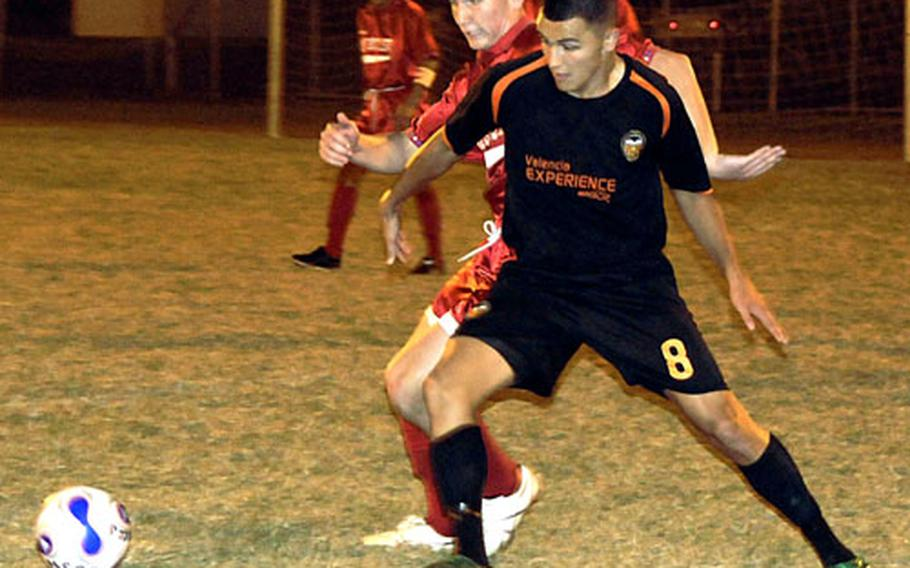 3rd Marine Logistics Group forward/mid Adam R. Rivera (8) battles Marine Corps Base Camp S.D. Butler midfielder Mike Muller for the ball Friday at the championship game of the 2008 Far East Regional Soccer Tournament on Camp Foster, Okinawa. 3rd MLG repeated its tournament championship, winning the match 4-2.