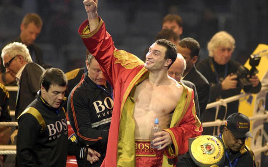 Wladimir Klitschko reacts to cheering fans after beating Hasim Rahman in the IBF, WBO, IBO heavyweight world championship fight at SAP Arena in Mannheim Saturday.
