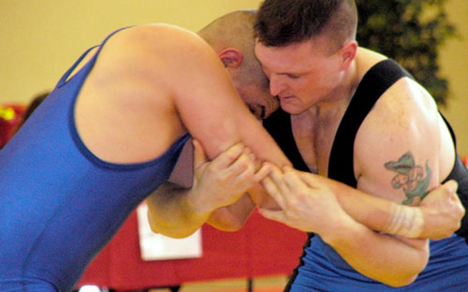 William Taylor, right, ties up with Jared Chumley in their 185-pound match at the U.S. Forces Europe Greco-Roman wrestling championships Saturday at Miesau, Germany. Taylor prevailed 8-5 in the battle between two Kaiserslautern-based wrestlers.