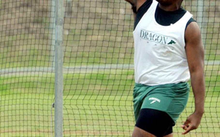 Kubasaki's Lamar King lets the discus fly during the second Okinawa Activities Council's track and field meet of the season Friday at Camp Foster, Okinawa. King won the event in 120 feet, ½ inch.