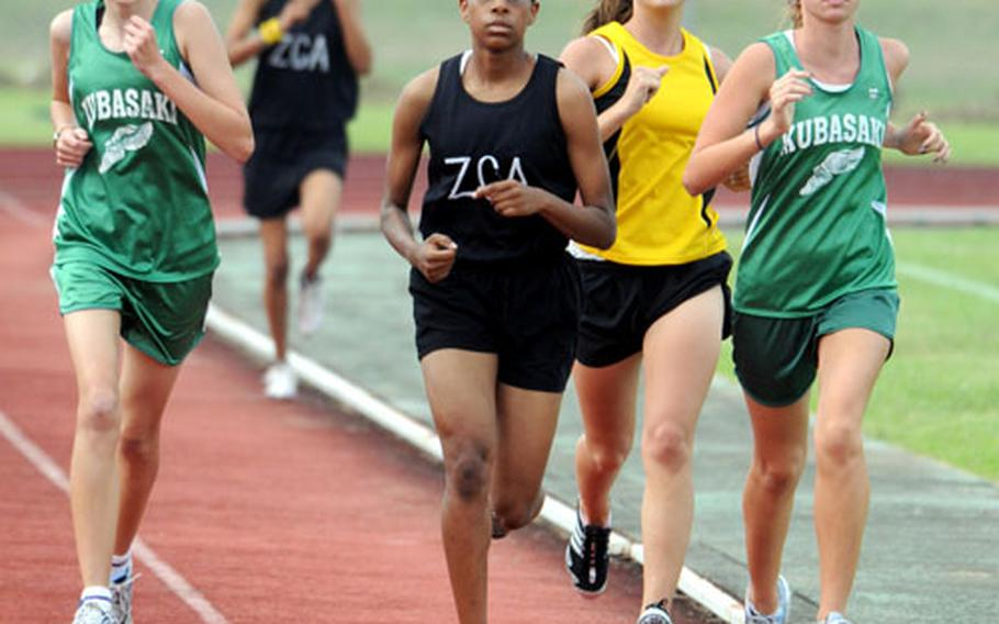 Kubasaki's Jessica Powell, right, leads the pack as teammate Amanda Henderson, Zion Christian Academy's Teauna Baker and Kadena's Britni Dougherty give chase during the two-mile run. Powell won the event in 13 minutes, 32 seconds.