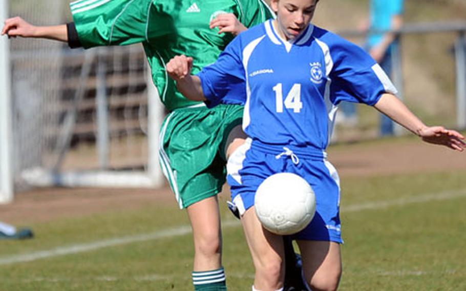 Wiesbaden's Celine Ponte moves the ball upfield against SHAPE's Katelyn Grabski.