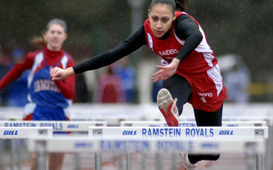 Kaiserlslautern senior Shalisa Baldwin races to victory in the girls 100-meter hurdles Saturday at Ramstein. Coaches cut the meet short due to heavy rain and hail.