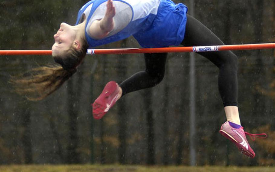 """Bitburg's Kristen Willeford from Bitburg glides over the high jump bar Saturday at Ramstein. Willeford beat out Tara Lookbaugh of Ramstein, clearing 5'2""""."""