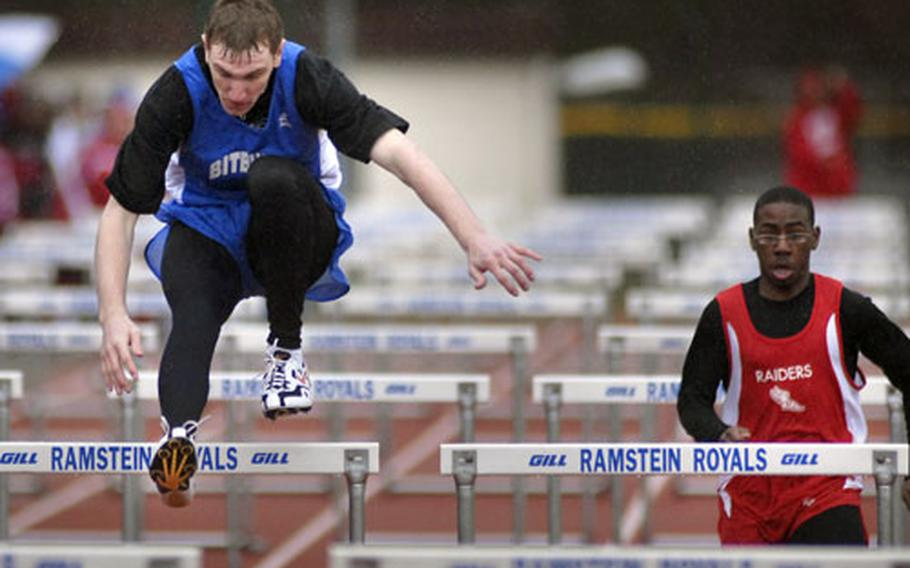 Corey Armstrong of Bitburg heads for a win in the 100-meter hurdles, an event in which he was competing for the first time.