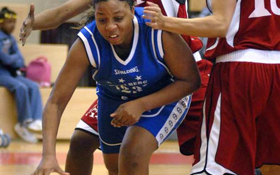 Amelia Tillman of Heidelberg of drives around Cynthia Jackson of Mannheim Sunday during their championship game at Mannheim's sports arena. Mannheim beat out Heidelberg 45-35 clinching the women's U.S. Army Europe title.