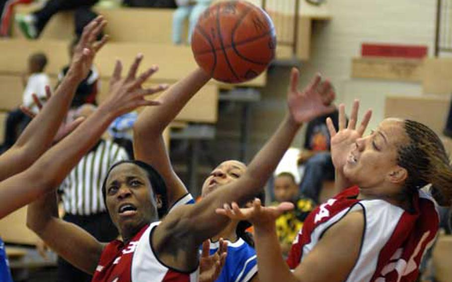 Lamanda Morant, center, and Angie Fields, right, of Mannheim battle for possession Sunday during their championship game against Heidleberg at Mannheim's sports arena. Mannheim beat out Heidelberg 45-35 clinching the women's U.S. Army Europe title.