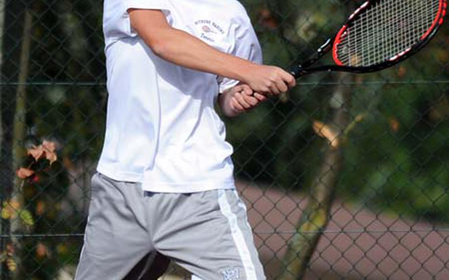 Bitburg's Tyler Jakobs slams the ball back across the net Saturday during his match against Ramstein's Clay Marquardt in Bitburg. Jakobs won the home match 2-6, 7-5, 6-3.