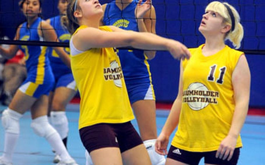 Baumholder's Brandi Burkley, left, bumps the ball in front of teammate Christy Williams, as Wiesbaden's Ashley Smith, center, keeps her eyes on the ball. Wiesbaden won the match in Ramstein on Saturday 25-19, 25-22, 25-16.