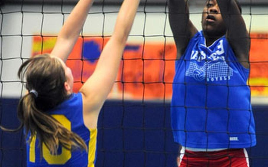 Ramstein's Nadia Booker, right, slaps the ball over the net, as Wiesbaden's Catherine Jerez tries to block. Ramstein won the match 25-12, 25-14, 25-13 at home on Saturday.