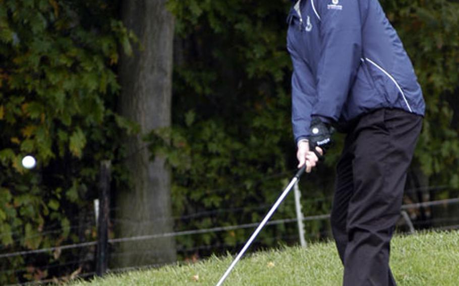 Lakenheath's Tyson Campbell watches his chip shot roll onto the green.