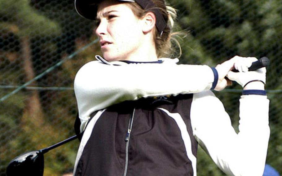 Hollie Salvo, a sophomore from Wiesbaden, watches her opening drive of the 2009 DODDS-Europe golf tournament at Rheinblick Golf Course in Wiesbaden, Germany.